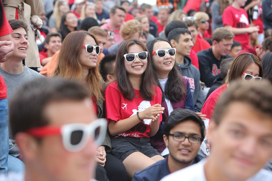 Three girls with RPI sunglasses on at an orientation event